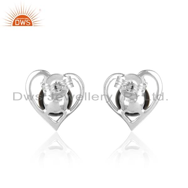 Designer of Designer heart studs in rhodium plated silver gray pearl and cz