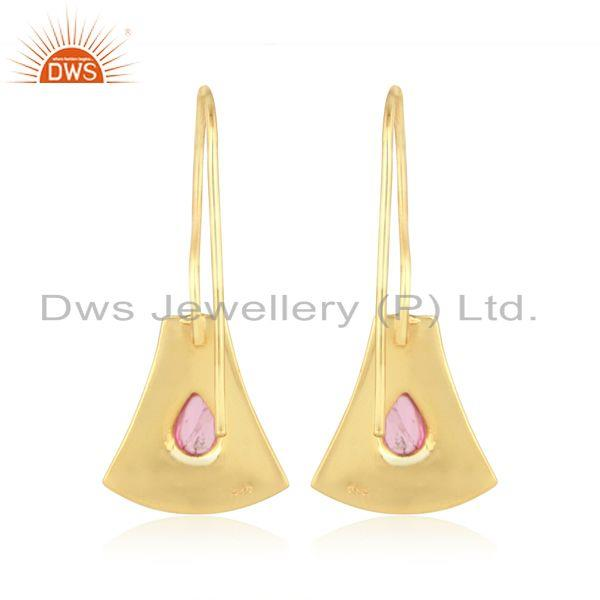 Designer of Jaguar textured earring in gold on silver with pink tourmaline