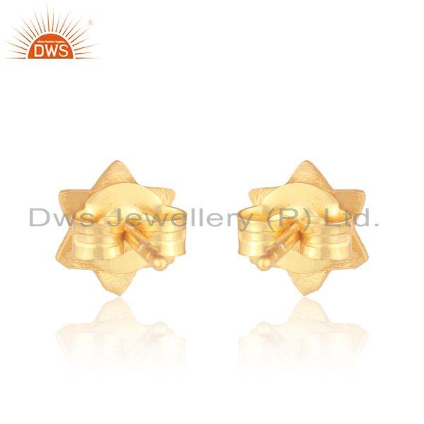 Designer of Handcrafted scratch finish star stud in yellow gold on silver 925