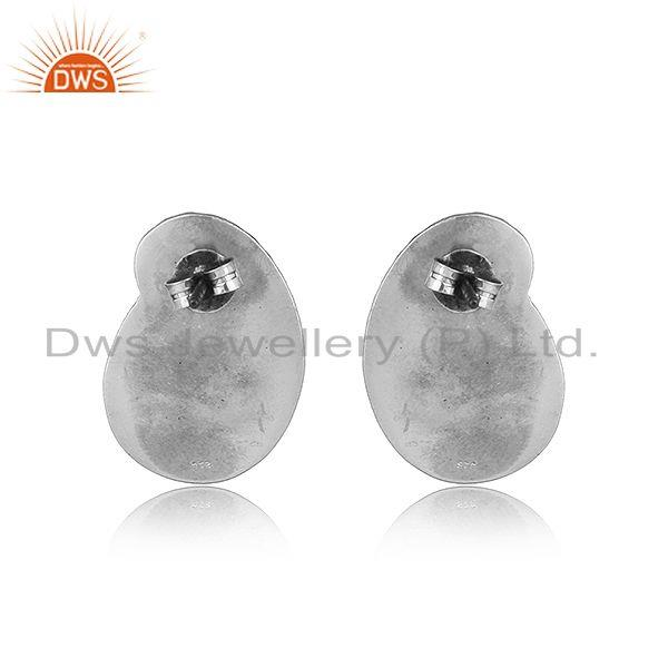 Designer of Traditional design hand textured tribe stud in oxidized silver 925