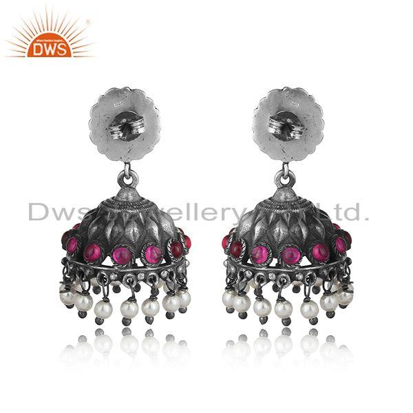 Designer of Traditional design textured tribe red stone jhumka in oxidized silver