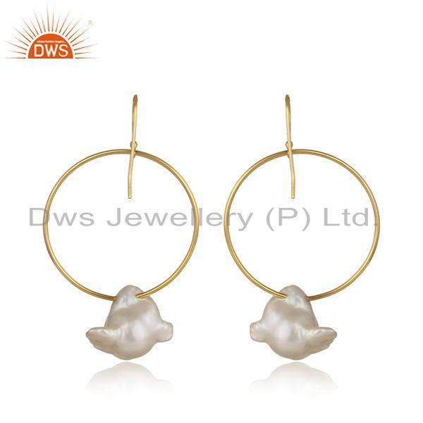 Designer of Handcrafted bold hoop yellow gold on silver dangle with pearl