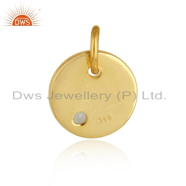 Designer of Dainty charm pendant in yellow gold on silver with aqua chalcedony