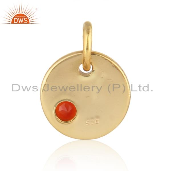 Designer of Dainty charm pendant in yellow gold on silver with red onyx