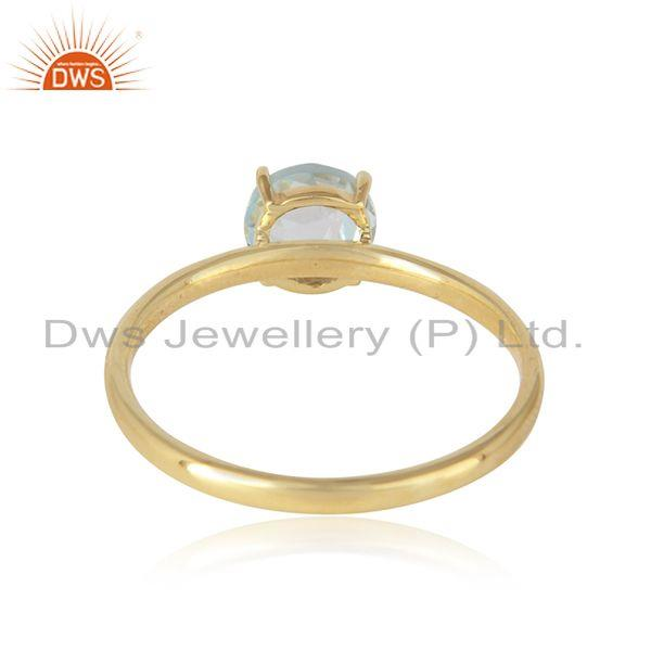 Designer of Solitaire ring in yellow gold on silver with natural blue topaz