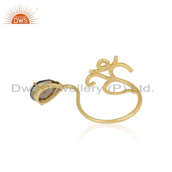 Designer of Dainty om symbol ring in yellow gold on silver 925 and pyrite