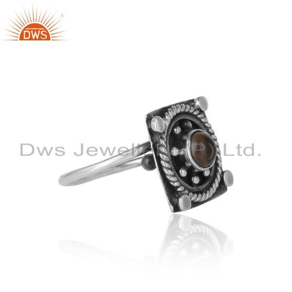 Designer of Designer rings in oxidized silver and smoky gemstone