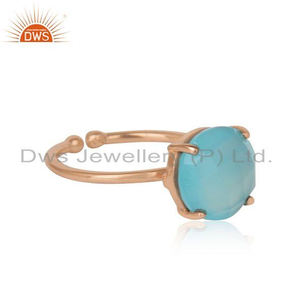 Designer of Handcrafted solitaire aqua chalcedony ring in rose gold on silver