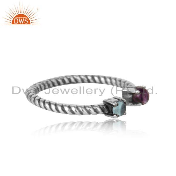 Designer of Dainty twisted ring in oxidized silver amethyst and blue topaz