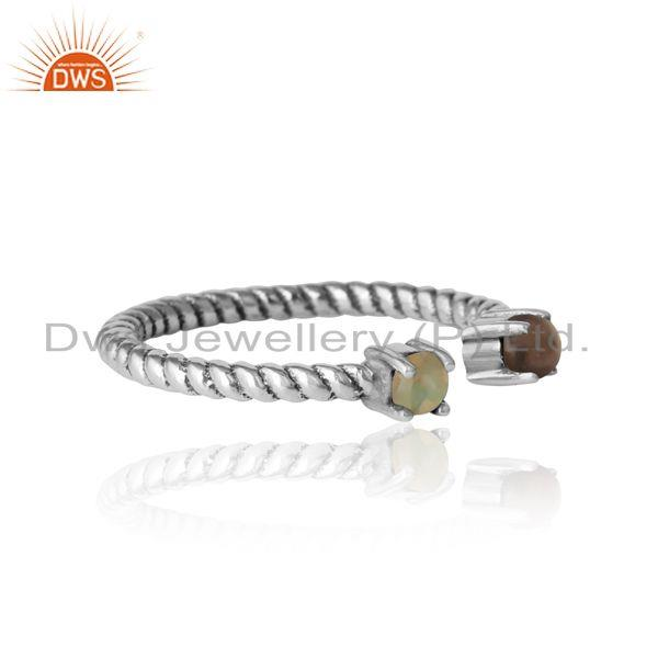 Designer of Dainty twisted ring in oxidized silver smoky and ethiopian opal