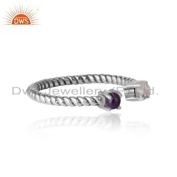 Designer of Twisted ring in oxidized silver rainbow moonstone and amethyst