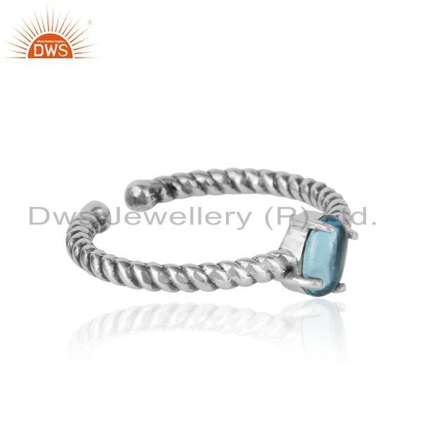 Designer of Dainty oxidized silver ring adorn with tilted natural blue topaz