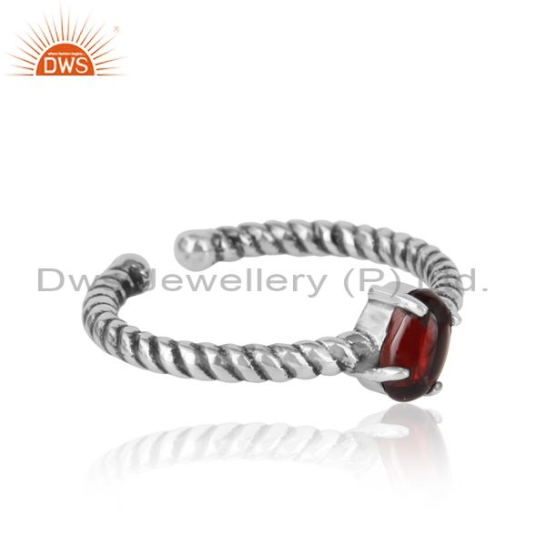 Designer of Dainty oxidized silver ring adorn with tilted natural garnet