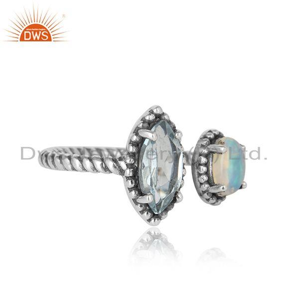 Designer of Oxidized silver twisted ring with ethiopian opal and blue topaz