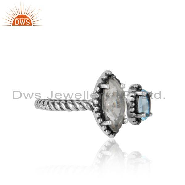 Designer of Twisted designer oxidized ring in silver blue topaz and crystal