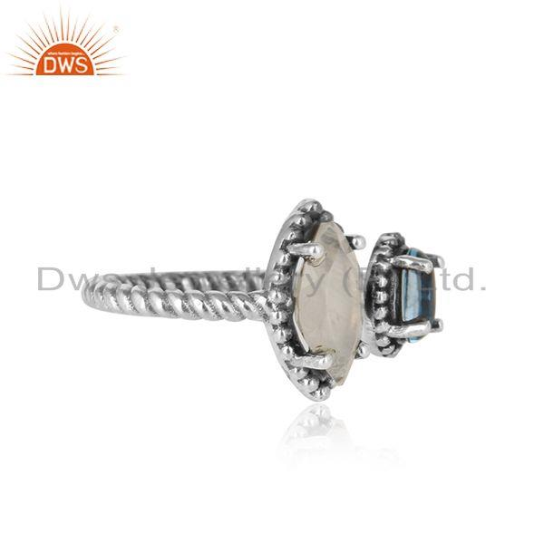 Designer of Oxidized silver twisted ring with rainbow moonstone blue topaz
