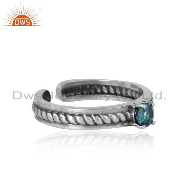 Designer of Designer twisted ring in oxidized silver 925 and blue topaz