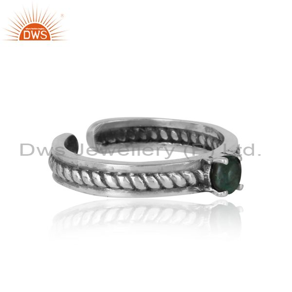 Designer of Designer twisted ring in oxidized silver 925 and emerald