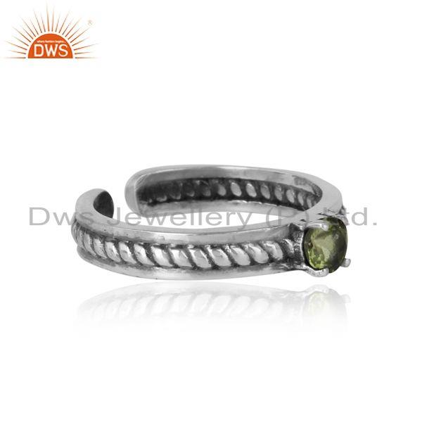 Designer of Designer twisted ring in oxidized silver 925 and peridot