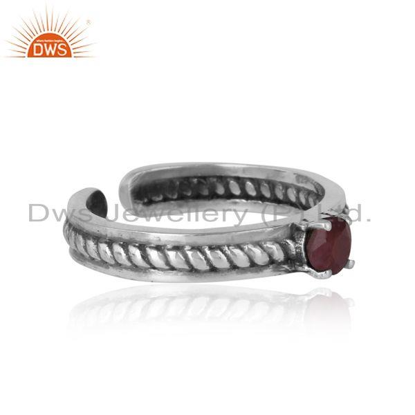 Designer of Designer twisted ring in oxidized silver 925 and ruby