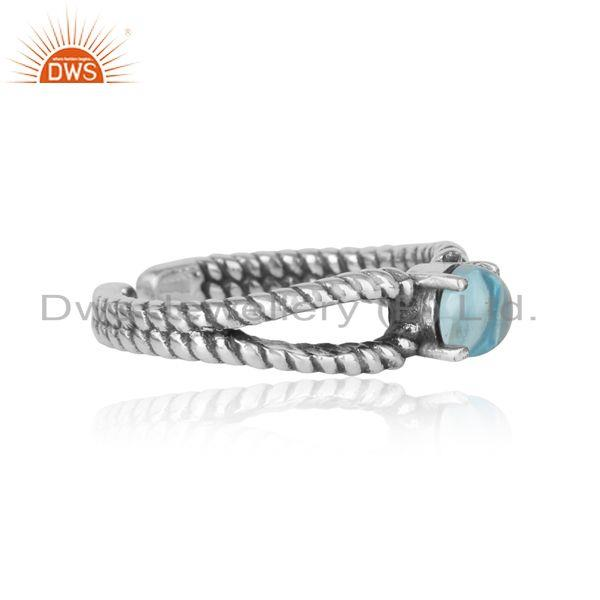 Designer of Blue topaz designer twisted ring in oxidized silver 925