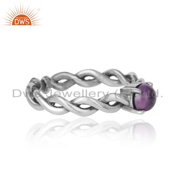 Designer of Dainty twisted ring in oxidized silver 925 with natural amethyst