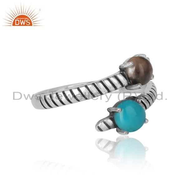 Designer of Handmade bypass ring in oxidized silver arizona turquoise smoky