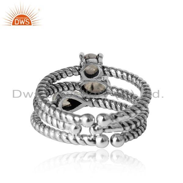 Designer of Twisted stackable oxidised silver ring set with rainbow moonstone