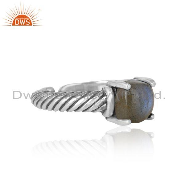 Designer of Handcrafted twisted bold ring in oxidized silver and labradorite