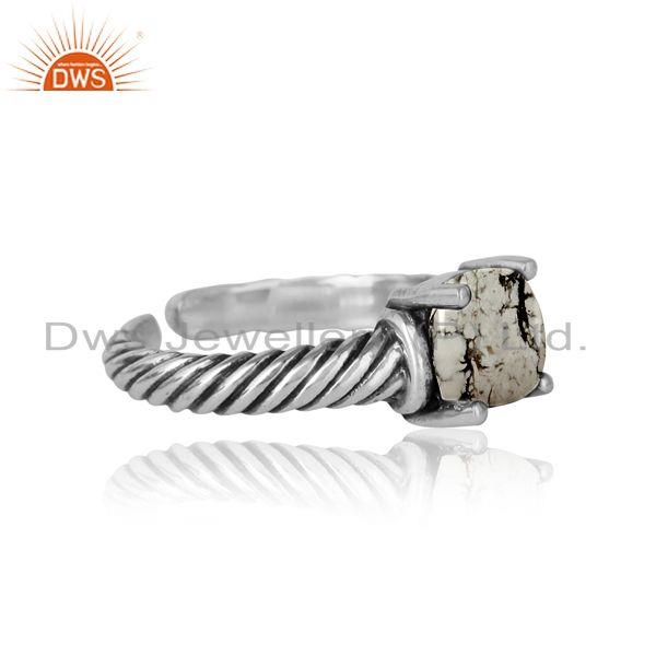Designer of Handcrafted twisted bold ring in oxidized silver white howlite