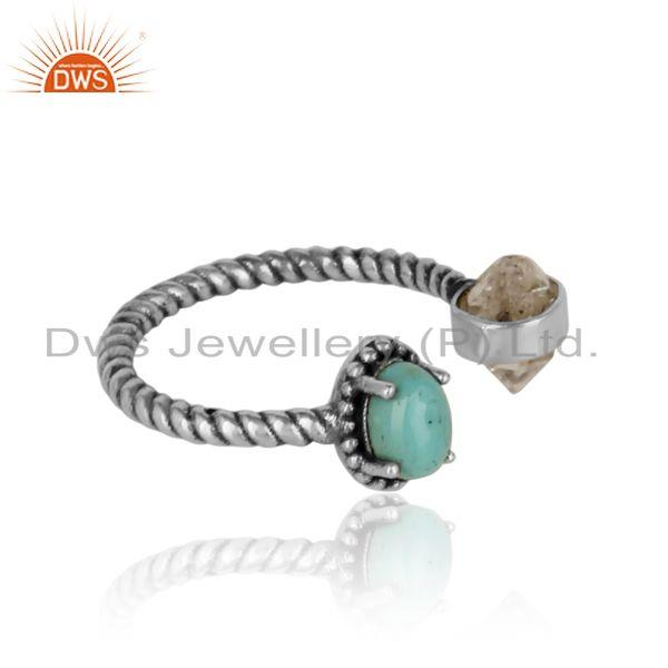 Designer of Herkimer diamond ring in oxidized silver with arizona turquoise