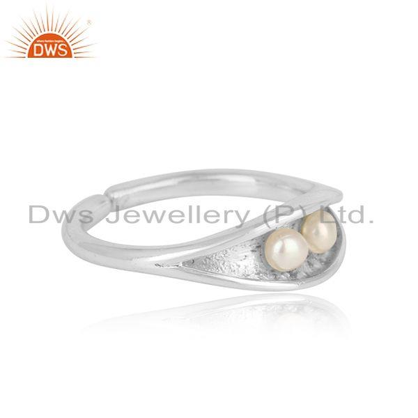 Designer of Seedpod designer dainty ring in solid silver and natural pearl