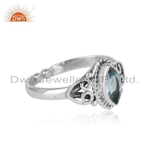 Designer of Exquisite textured dainty blue topaz ring in oxidized silver 925