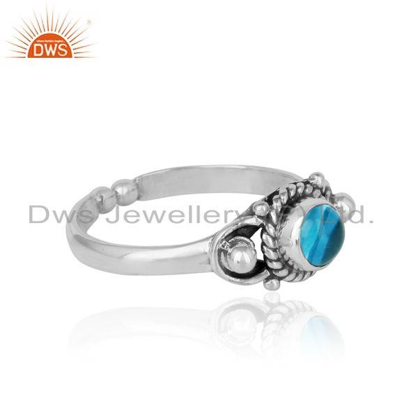 Designer of Handcrafted twisted textured blue topaz ring in oxidized silver