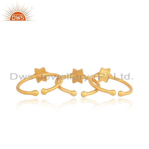 Designer of Textured dainty multi star 3 rings set in yellow gold on silver