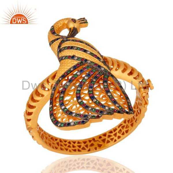 Wholesalers of 18k yellow gold on silver 925 cubic zirconia peacock design bangle