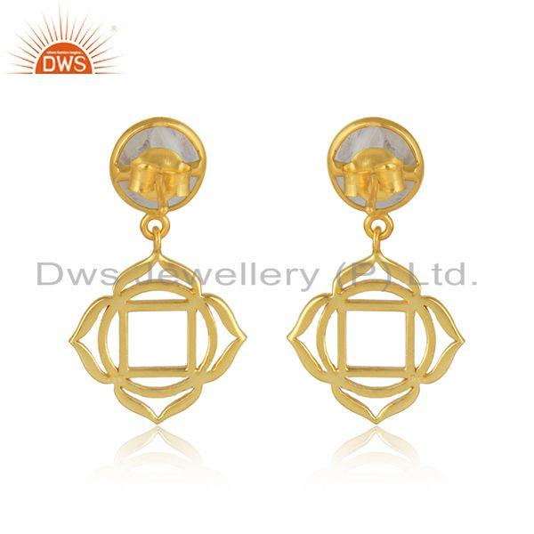 Designer of Muladhara earring in yellow gold on silver with rainbow moonstone