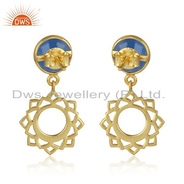 Designer of Heart chakra earring in yellow gold on silver with blue chalcedony