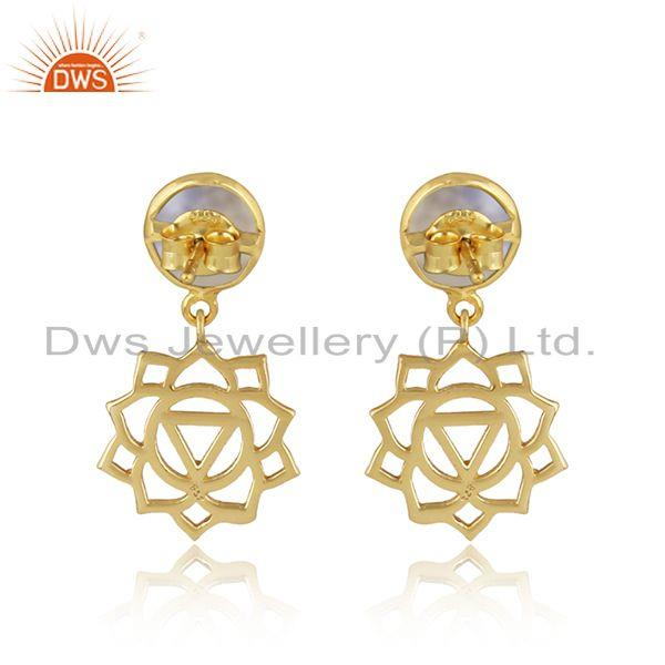Designer of Manipura earring in yellow gold on silver with rainbow moonstone