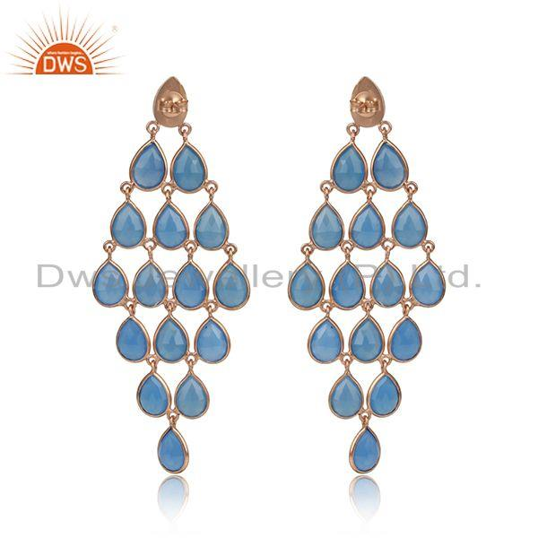 Designer of Designer long blue chalcedony chandelier in yellow gold on silver