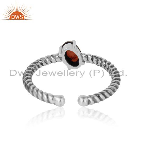 Exporter of Dainty oxidized silver ring adorn with tilted natural garnet