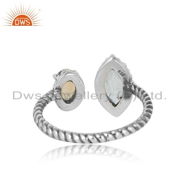 Exporter of Oxidized silver twisted ring with ethiopian opal and blue topaz
